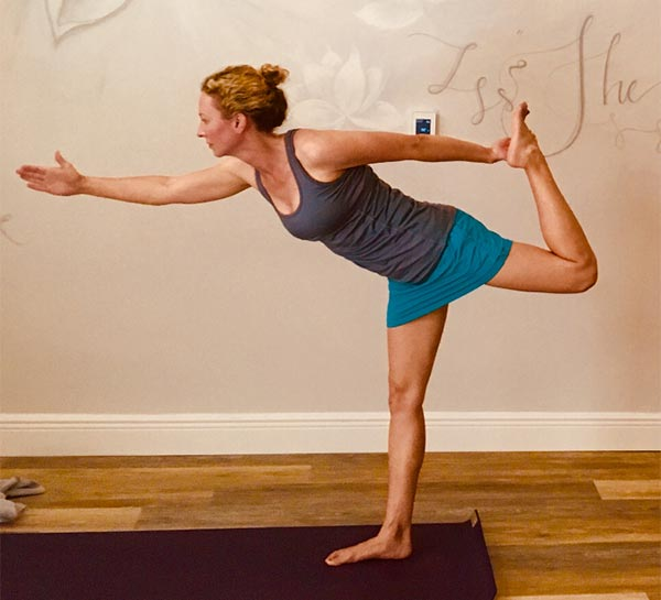 Woman Improving Her Health with Hot Yoga